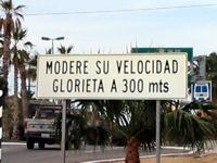 Moderate your speed approaching plaza or square, in 300 meters